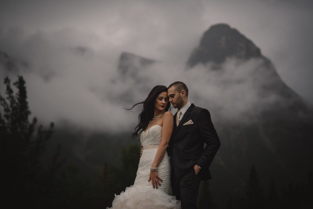 Bride and Groom portrait in front of misty mountain