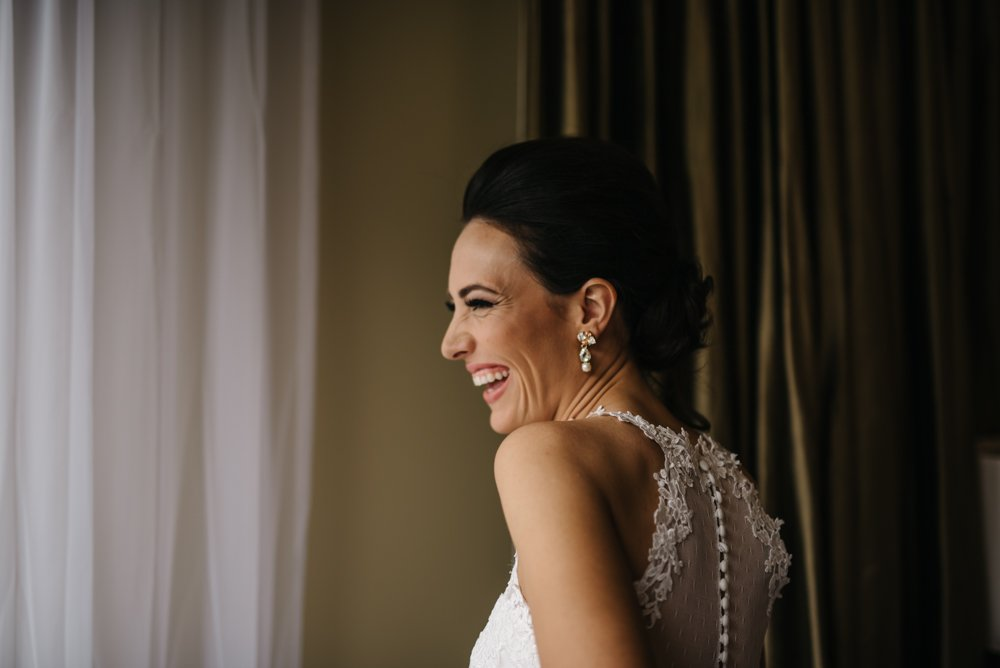 Bride wearing wedding dress smiling