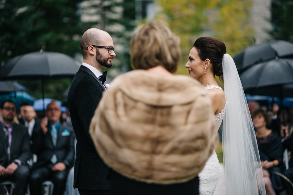 wedding ceremony in the rain in Banff