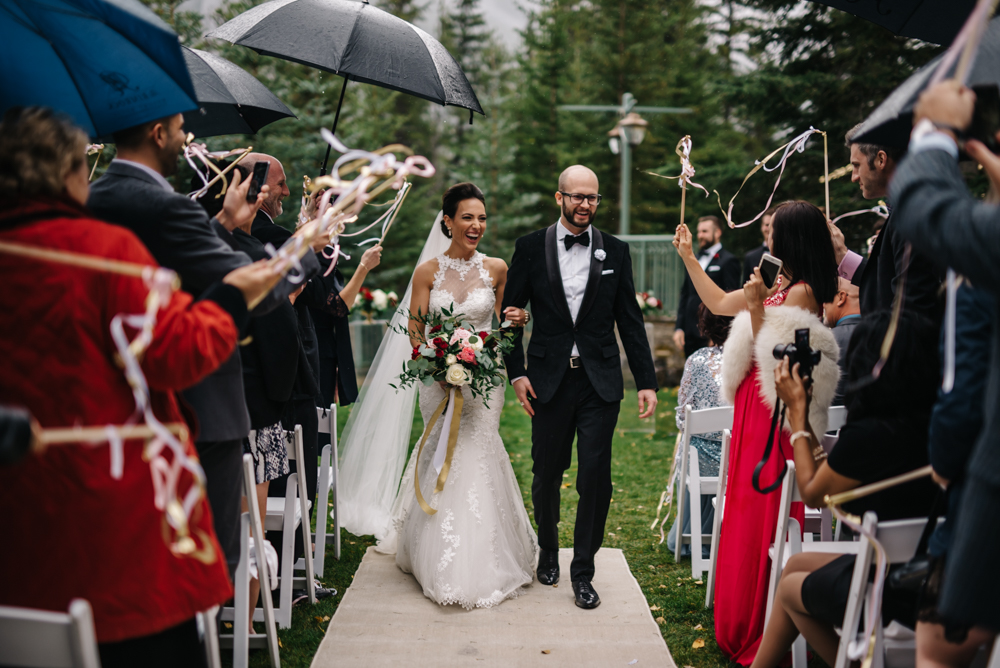 wedding exit in the rain in Banff