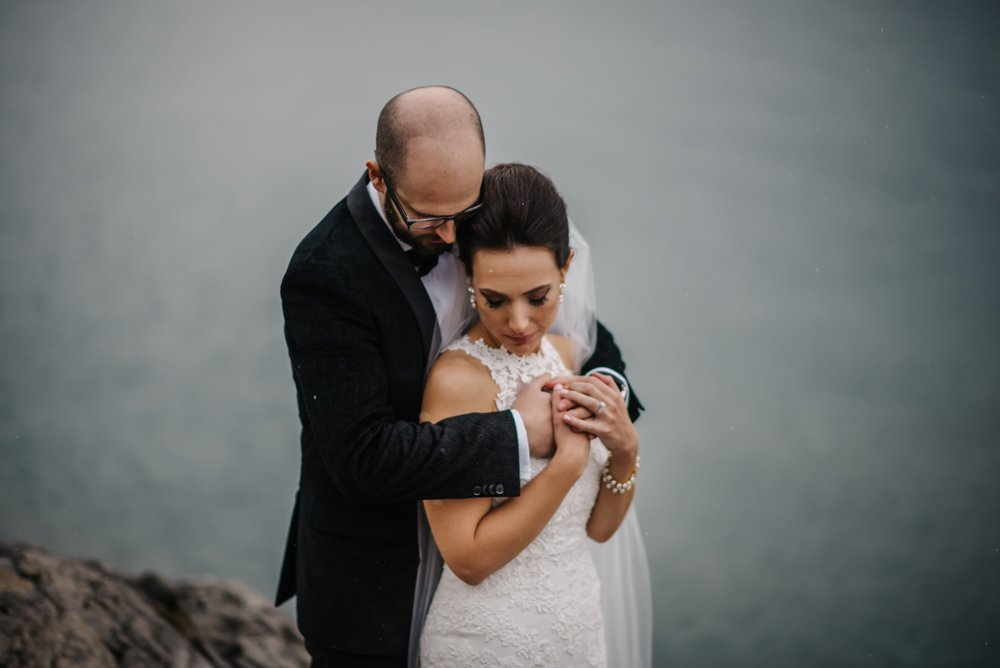 bride and groom wedding photos in the rain