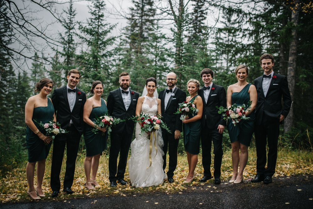 wedding party photos in Banff in the rain