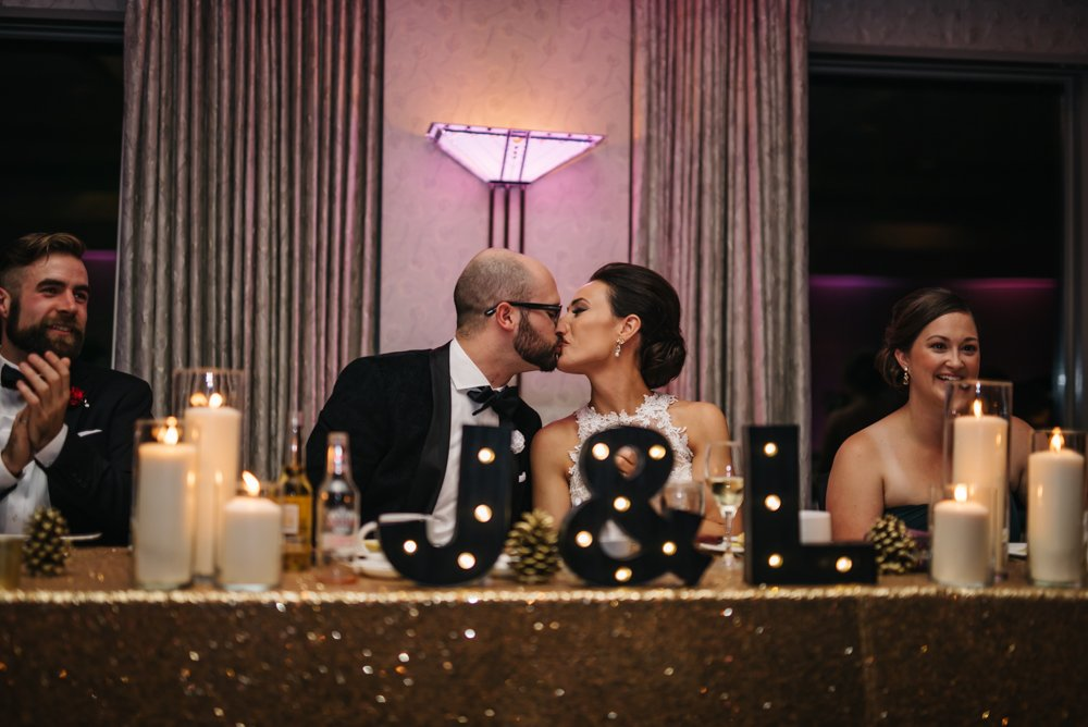 kissing game at wedding reception in Banff Alberta